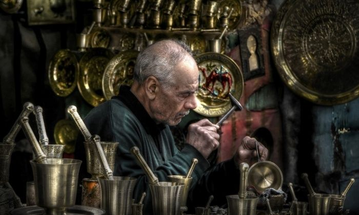 Love a good portrait, particularly one that offers a special kind of insight - Souk worker (Tunis). Photograph: Victor Melo