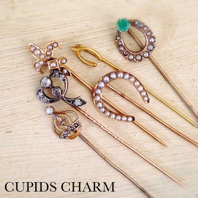 On my workbench - pretty antique stickpins about to be converted into rings. #gold #diamonds #seedpearls #emerald #opal #fleurdelis #lucky #horseshoe #crown #bow #victorian #edwardian #soontoberings #antiquejewelry #stickpins