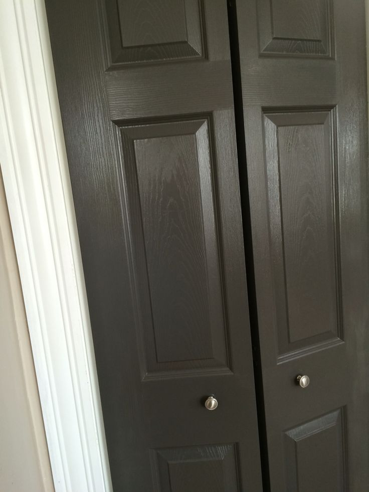 Behr Intellectual in Semi-Gloss (paint + primer) -- painted interior door in a dark gray / charcoal