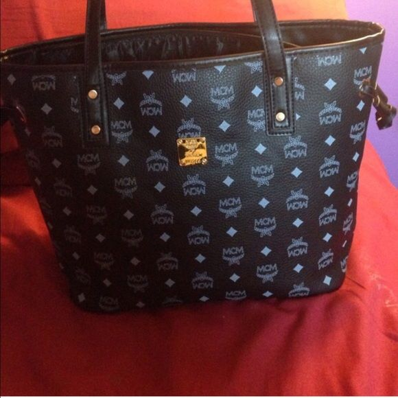 NWOT Black MCM Purse black & white MCM purse.. bought off another posher & paid $170 for it! brand new. MCM Bags Shoulder Bags