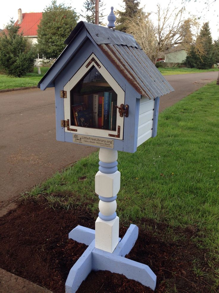 "Barbara D. Brownsville, OR. #LittleFreeLibrary #FreeLittleLibrary ""I am a retired Children's Library Assistant, who moved from the big city to the small town of Brownsville, Oregon. My sweetheart made me my own little library because he knew how badly I wanted one. I love sharing books with my community. I painted it white to match our 1891 farmhouse. The periwinkle trim?...because I like the color periwinkle!"""