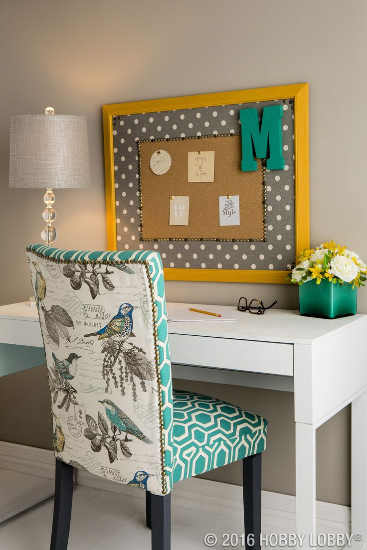 There's more than one way to spin the decorative-nail look. Pair nails with a bright color palette and bold, unfussy prints—and stuffiness doesn't even come into play. Board and chair: faux nailhead trim, sold by the roll.