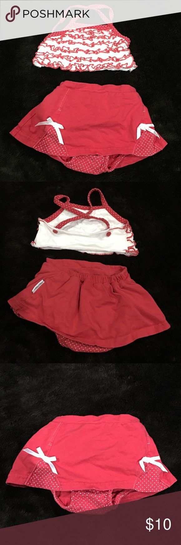 Vitamin kids 2 piece swimsuit Red two piece skirt bottom and ruffle top swimsuit. I purchased this second hand as a swimsuit but fabric is cotton instead of a swimsuit material which I strange to me. Either way it's in GUC and is super super cute with minimal wear. Vitamins Baby Swim Bikinis
