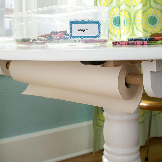 Make paper easily accesible for kids by installing a holder for a spool of paper under a table. More DIY storage solutions: http://www.bhg.com/decorating/do-it-yourself/accents/diy-storage-for-every-room/?socsrc=bhgpin072412paperspoolholder#page=10