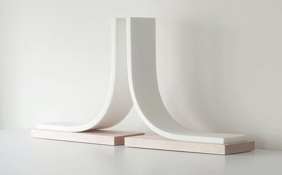 This elegant pair of bookends are handmade from Canadian maple and a synthetic…