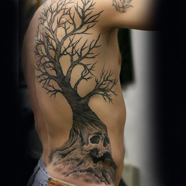 Man With Skull Tree Rib Cage Side And Back Tattoos