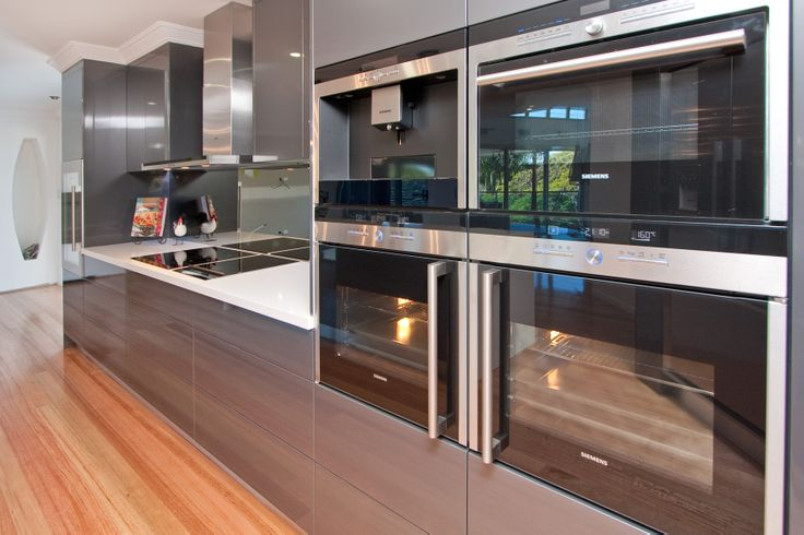 High gloss finishes extend the impact of textured flooring beautifully. www.onecallkitchens.com.au