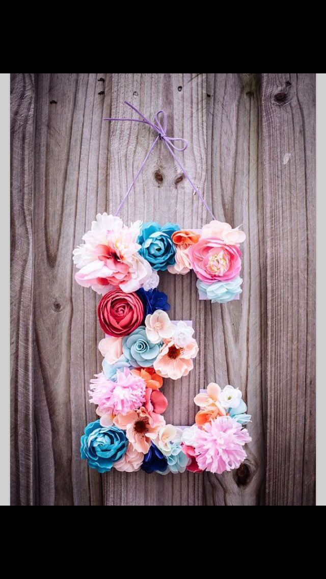 Flower letter would be cute to do at the headband table with extra flowers not used to make headbands or in addition so that can be used in baby room for décor.