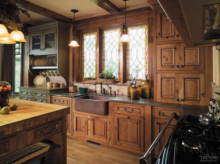 The kitchen faucetry has the appearance of a classic farmhouse spout, but offers full contemporary functionality. A copper farmhouse sink is a modern interpretation of an age-old utility. The copper finish is reflected in the island countertop, bringing aspects of harmony to a diverse collection of pieces.