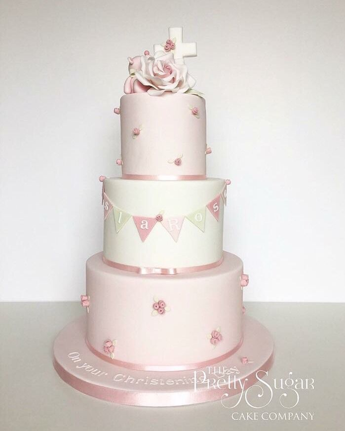 Pink and white rosebuds and bunting christening cake with teddy, sugar rose and cross details