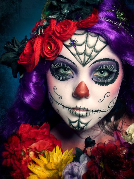 Dia de Los Muertos Sugar Skull makeup accented with gems.