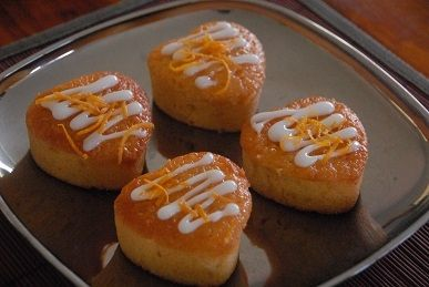 Orange & almond love hearts topped with lemon sherbet glaze - gluten and dairy free.