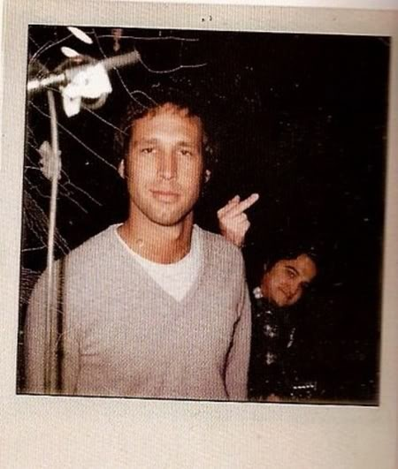 Haha! Chevy Chase gets the finger by John Belushi on Saturday Night Live. Priceless ;) SNL (70's photo bomb)