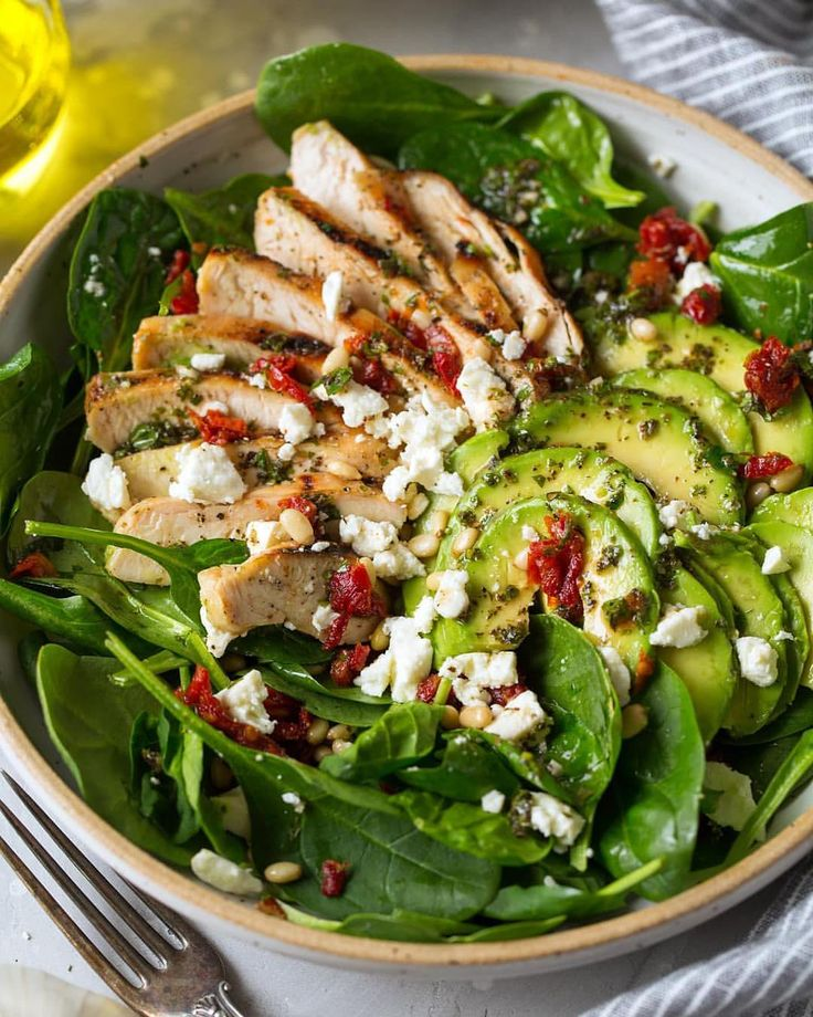 """Grilled Chicken Sun Dried Tomato and Avocado Spinach Salad - in other words the """"all the best things salad""""! . It is jam packed with flavor and you can't go wrong with a grilled chicken salad packed with healthy ingredients for dinner. RECIPE LINK IN BIO . . . #cookingclassy #buzzfeedfood #buzzfeast #beautifulcuisines #bhgfood #comfortfood #eeeeeats #feedfeed #foodandwine #foodstagram #foodblogeats #f52grams #fwx #foodandwine #huffposttaste #instafood #instayum #food #onthetable #onmytable…"""
