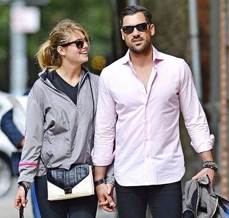 Maksim Chmerkovskiy and Kate Upton hold hands as they walk through New York City.