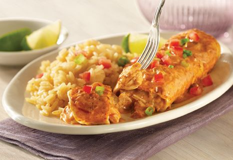 Kicked-up with Pace Picante Sauce and chili powder, Easy Chicken and Cheese Enchiladas are a perfect way to use leftover chicken!