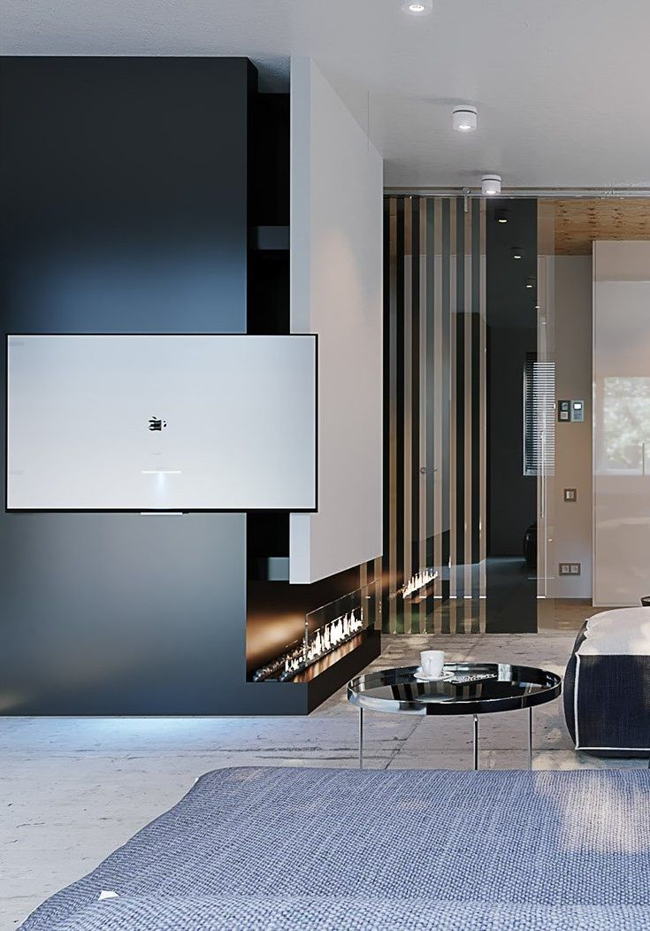 Thinking about adding a zoom-squish fireplace to your small living room design? This chimney is a feature all in itself! And the white and black colour scheme contrast perfectly with the cement flooring and glass doors.