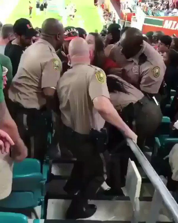 Drunk girl swings on a cop at the Miami game https://twitter.com/barstoolsports/status/927011990169669632 | Visit http://www.omnipopmag.com/main For More!!! #Omnipop #Omnipopmag