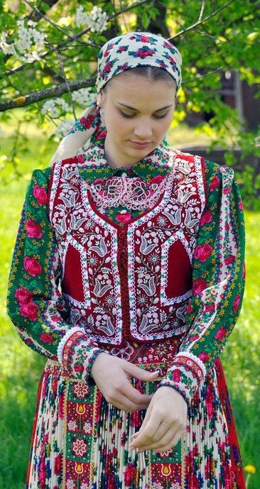 A young woman wearing the traditional costume in Hungary. Splendid embroidery work!