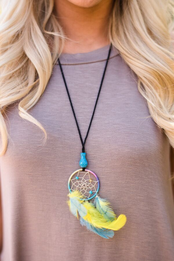 Dream a little dream with these miniature dreamcatcher necklaces. Adorned with a small ceramic bead at the base. - Slip on style - Authentically handcrafted
