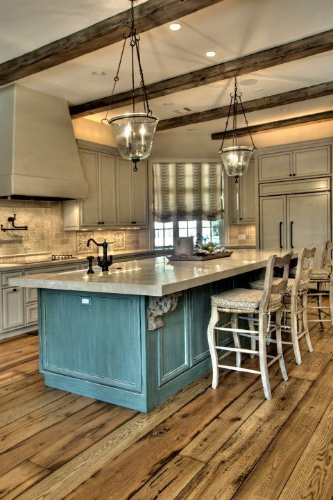 Kitchen is beautiful from floor to ceiling. I would not do the blue island,  but it love the gray cabinets with the floor and ceiling beams.