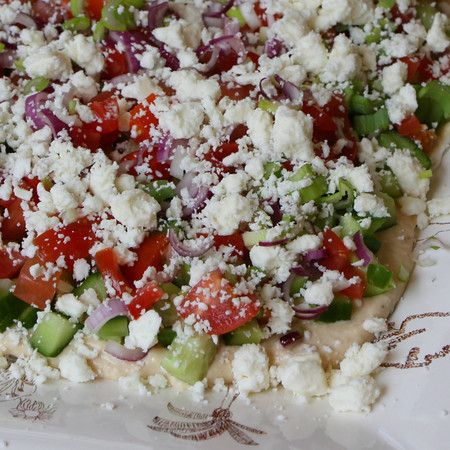 Layered Greek Dip is so good! Hummus, cucumber, feta, tomatoes and olives!