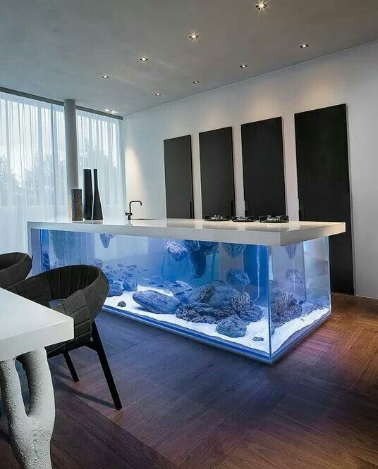 A kitchen unit with functioning sink giving a whole new meaning to 'Having fish for tea'.  I love fish tanks, at one time I  had a house full of them a total of 10.  None at the present, so I would love one.  I have the perfect place to put one a built in bar between my formal living room and kitchen. You can see it from both sides.   .#LGLimitlessDesign & #Contest