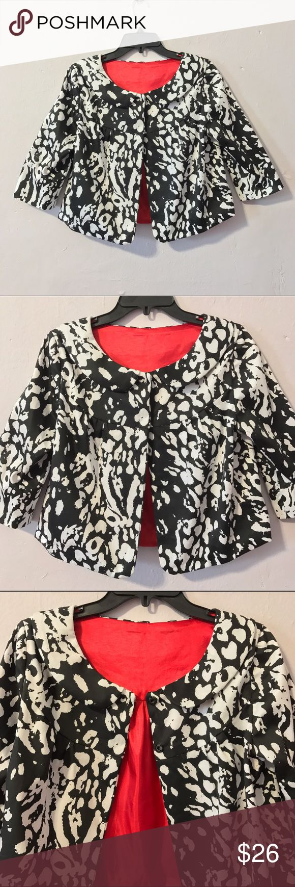 Cheetah print bolero jacket contrast lining blazer Cute black and white cheetah print bolero jacket with red contrast lining. Peter Pan collar; 3/4 sleeves; opens and closes with two large snaps; boxy/oversized fit. Great for work or lunch with the ladies- looks very chic with an all black fitted outfit. Best fits standard size Small. Never worn and in perfect condition. Cheetah print fabric is cotton with slight stretch. Jackets & Coats Blazers