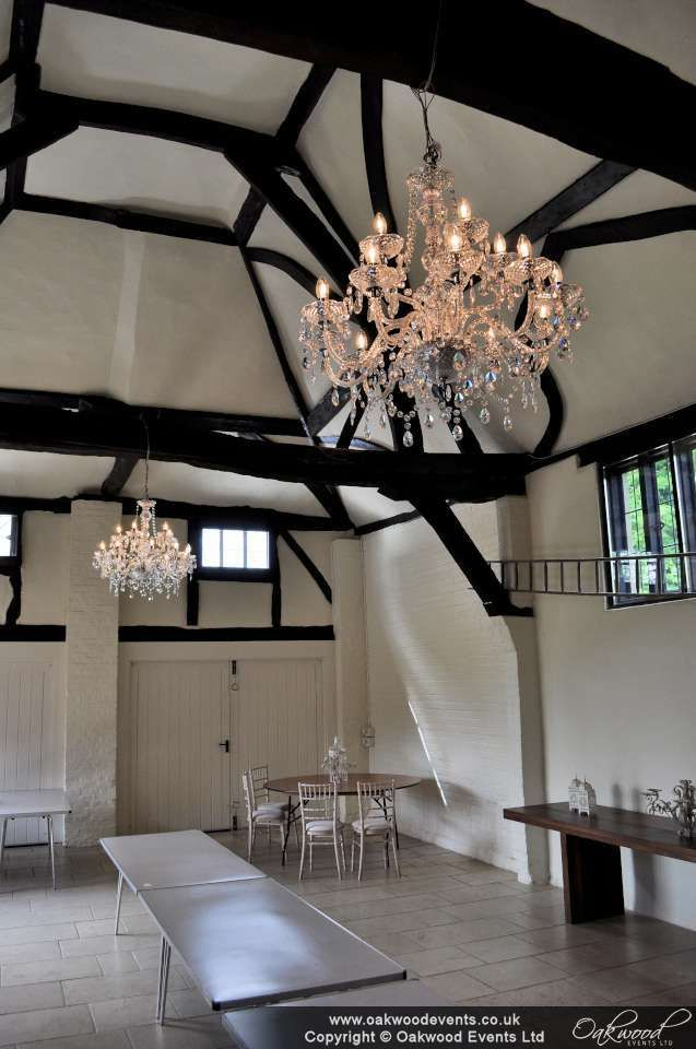 Pair of crystal style chandeliers in the barn at NWH