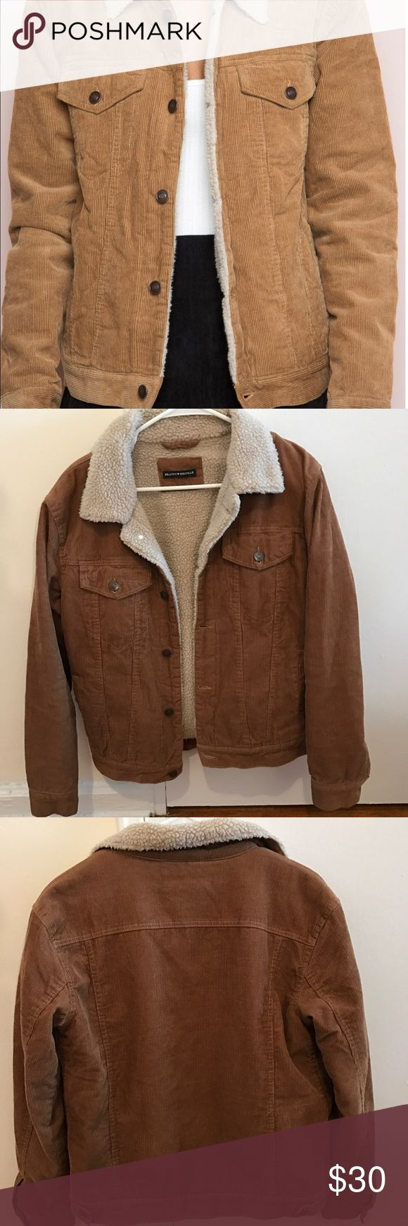 Brandy Melville Tan Elisha Corduroy Jacket Gently used condition, some general wear seen on the inner fur. One size. See measurements:  With the garment closed I measured about 19 in. from pit to pit. For length, from the highest point of the shoulder (next to the seam connecting to collar) I measured 24.5 in. From shoulder next to arm seam (lowest point on shoulder), I measured about 22 in. While I think this would probably fit a medium best (or small for looser fit), please look at…