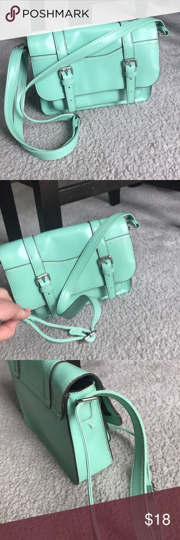 MOSSIMO MINT green Crossbody/Shoulder Bag Excellent condition- Inside and out - PLEASE SEE THE CLOSE UP PIC - very faint pen mark.  Silver tone hardware. Man made materials . One easy access pocket under the bucked flap. Then inside has slot pockets for phone and a zipper pocket. Medium sized bag. Any questions please ask 😃 Mossimo Supply Co Bags Crossbody Bags