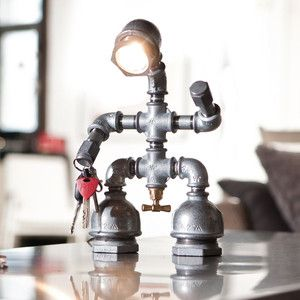 Kozo Man, the perfect silent partner, light source, and organizing solution. His adjustable magnetic hands keep track of your keys, paper clips, scissors, staples, and more. Kozo Man's feet are padded to keep your desktop free of scratches. A variety of other light fixtures as well!