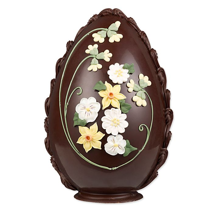 Bettys Dark Chocolate Spring Flowers Easter Egg | Inspired by designs that have been in the Bettys archives for generations, this handmade Swiss Grand Cru chocolate egg is decorated with exquisite royal icing primroses, pansies, narcissi and cowslips and has a traditional hand-piped decorative edging.