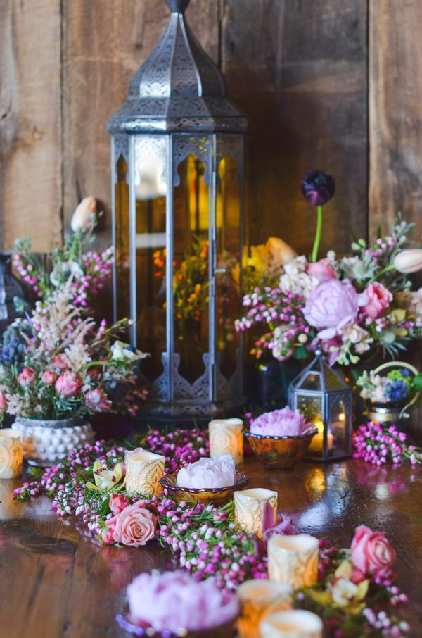 A Peach and Blush Floral Runner with Glowing Candles and Jewel Toned Lanterns…