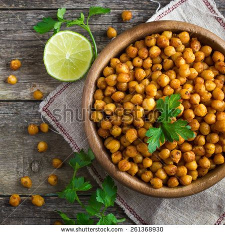 Roasted  spicy chickpeas on rustic background, top view, square image