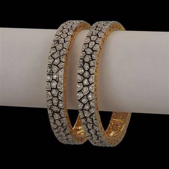 kundan antique bangles I found this beautiful design on Mirraw.com