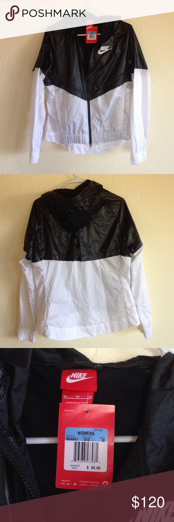 Nike black and white windbreaker NWT New with tags never worn. Seen a few people with an ISO for this! This item is authentic and not a copy like a few that I've seen on here! Nike Tops