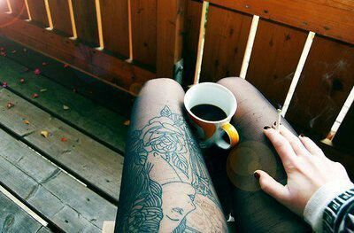 Thigh tattoo, coffee, cigarette