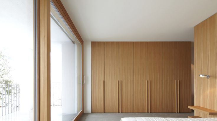 | DETAILS | INTERIORS | Photo Credit: #Bedroom inside the House on the Hill by #Holzrausch. When we begin to look at storage as an integrated visual continuation of space versus the traditional mindset of walk-in closets. Gone is the idea that a walk-in closet as luxury. When we begin to organize space as a program for order, a place for what we use daily, then we begin to live with less and only what we need. Walk in closets open to the excuse to treat as a dungeon by throwing mess in a…