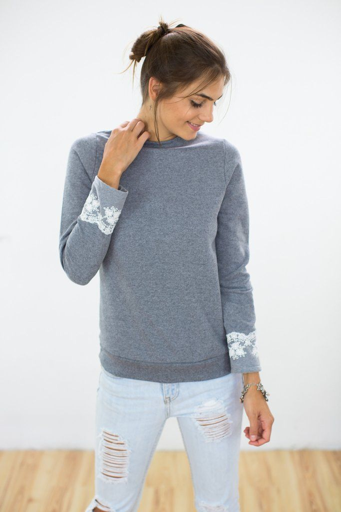 "Sweater Gently Gray Cosy sweater in gray sweatshirt fabric with fleece inside. The ""Gently"" sweater has a white lace ribbon along the cuffs adding an elegant, vintage touch to this otherwise simple sweater. http://shoko-shop.com/collections/new-in/products/sweater-gently-gray"