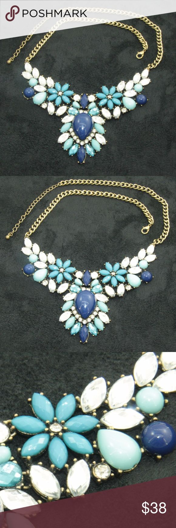 Blue Statement Statement Necklace Gorgeous colors: Marina Blue, Navy Peony, and Brilliant Clear Marquis Crystal Rhinestones and Clear Chatons.  Gold tone chain.  18 inches in length, adjustable to 21 inches.  Used item: any wear shown in pictures. Excellent condition. All stones intact.  Bundle Up!  Offers always welcome : ) Jewelry Necklaces