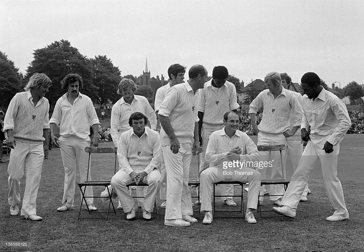 The Somerset players organise themselves for a team photograph prior to their Gillette Cup 3rd round match against Derbyshire at Ilkeston, 3rd August 1977. Somerset won by 59 runs. Left-right: Peter Denning, Dennis Breakwell, Keith Jennings, Mervyn Kitchen (seated), Colin Dredge, Brian Close, Joel Garner, Derek Taylor (seated), Brian Rose, Ian Botham (partly hidden) and Viv Richards.