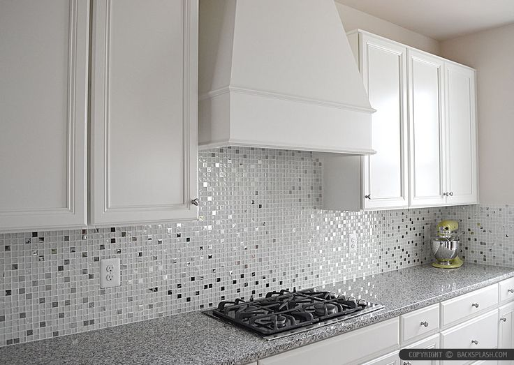 Luna Pearl Granite Countertop With White Glass Metal Kitchen Backsplash Tile And White Kitchen Cabinets