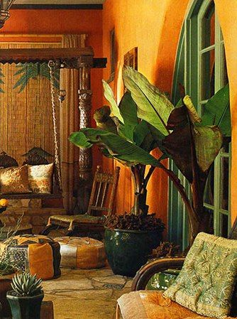 Tropical-chic Design... Loggia with a mix of spice colors and potted tropical plants - by Madeline Stuart