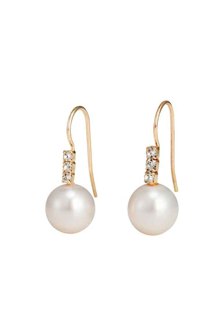 Pearly earrings: Earrings in metal decorated with sparkly stones and a plastic pearly bead. Length approx. 2.5 cm.