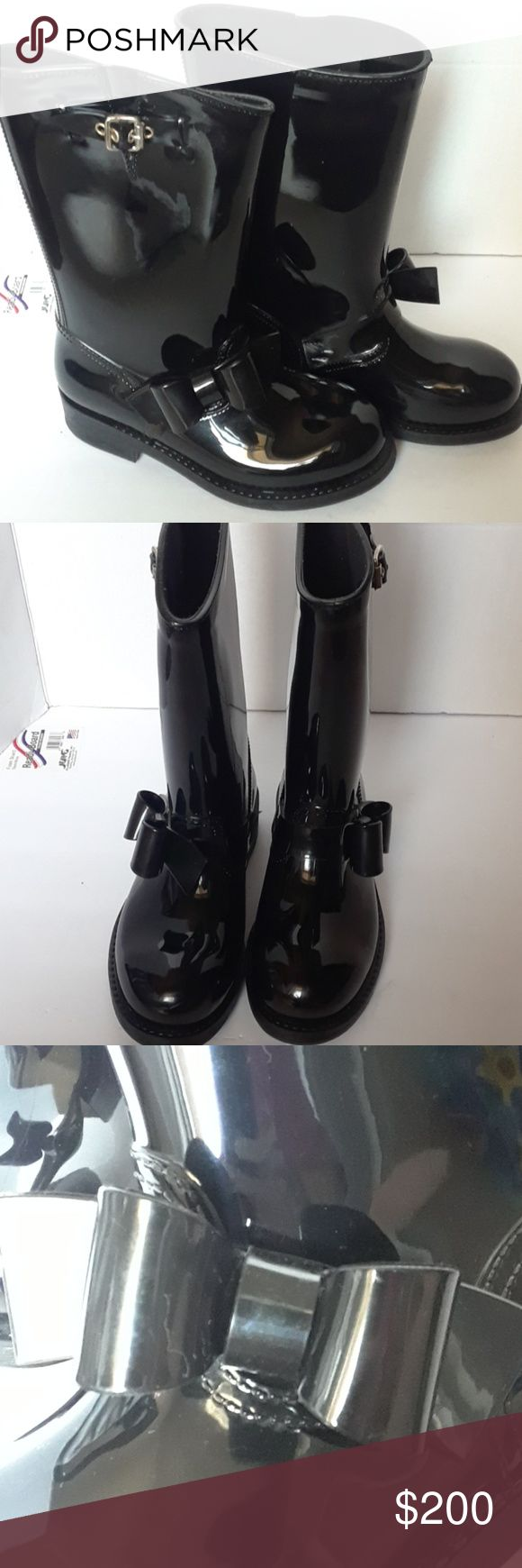 Valentino red black rubber boots size 6 Black Valentino Bow Trim Waterproof Rain Boot (Women) PVC rainboots with bow detail. Made in Italy. Bow detailing. Solid color. Rubber sole. Lined interior. Round toeline Worn a couple of times has a few small scratch marks on the inner side of them please look at picture no box paid over $300 app for all offers sorry no trades Valentino Garavani Shoes Winter & Rain Boots
