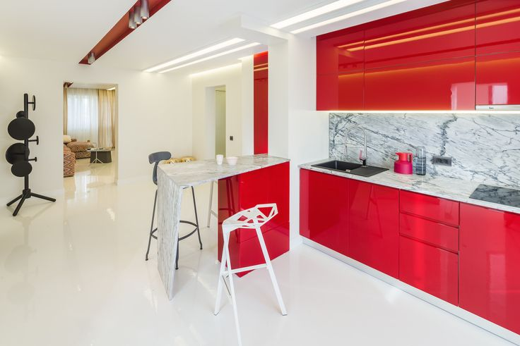 minimalist kitchen with marble countertop, fronts from glossy MDF in marsala color, push-to-open systems for doors