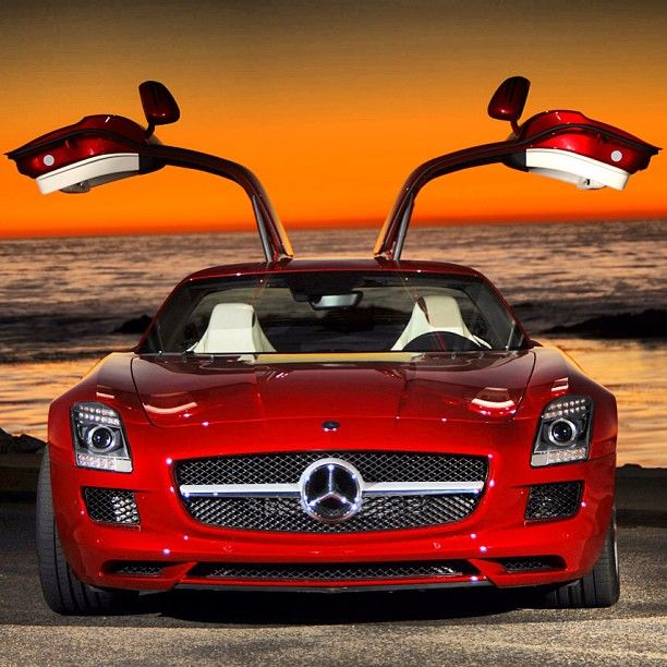 Mercedes-Benz SLS GT Coupe looking magnificent in a beach-side sunset.