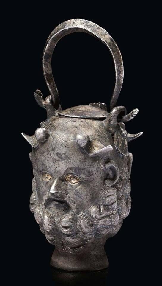 Roman silver with partial gilding Janus head balsamarium. 2nd-3rd century CE