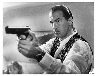 Can you name the movie? Hint: Seagal is married, but his wife is killed. He then hooks up with a new girl, his real life wife Kelly LeBrock.......